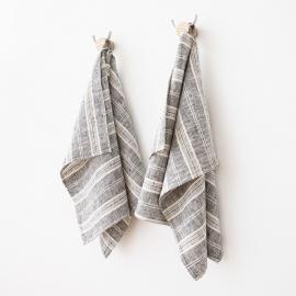 Un set di due asciugamani in lino nero bianco Multistrisce